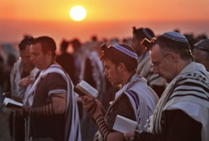 "Jewish worshippers wrapped in prayer shawls, participate in the special ""Blessing of the Sun"" prayer at sunrise on the Eitam Hilltop near the West Bank Jewish settlement of Efrata, Wednesday, April 8, 2009. Devout Jews around the world on Wednesday observed a ritual performed only once every 28-years, saying their morning prayers under the open sky in the ""blessing of the sun"", called the Birkat Hachamah in Hebrew. (AP Photo/ Kevin Frayer)"